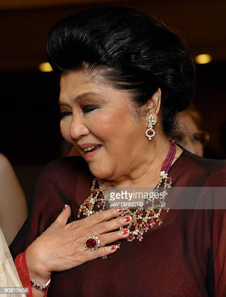 """Flamboyant former first lady Imelda Marcos arrives at the government-run Cultural Center of the Philippines for a special """"gala tribute"""", held in her..."""