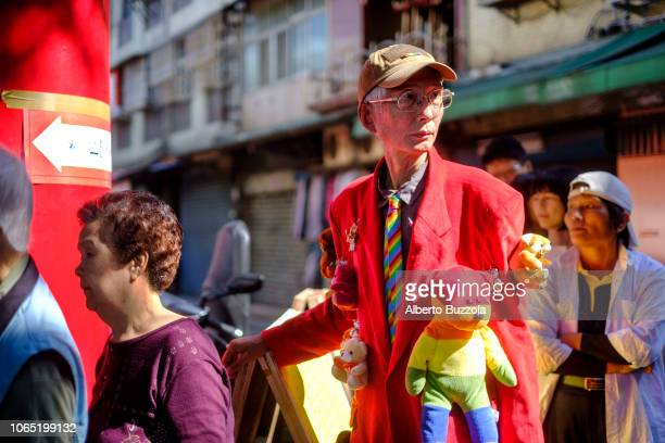 Flamboyant Veteran gay activist Chi Chia-wei, which goes also by the English name of Dayway Chief, queuing to cast his vote in the 9 in 1 election...