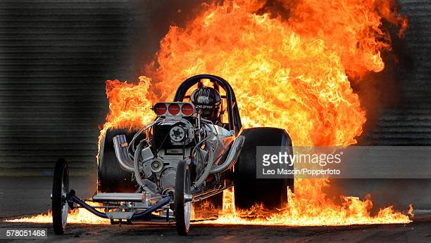 Flame burnout exhibition by Bob Hawkins in his Slingshot Dragster time Traveller at Santa Pod Raceway on July 17 2016 in Wellingborough England