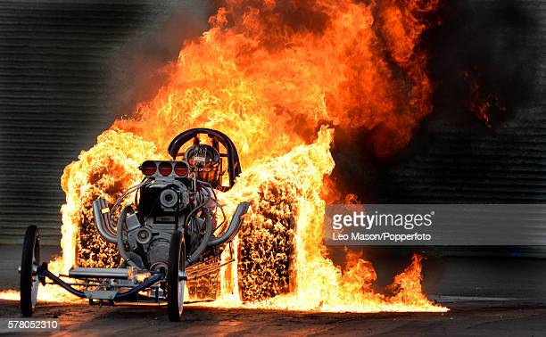 Flame burnout exhibition by Bob Hawkins in his Slingshot Dragster time Traveller at Santa Pod Raceway on July 16 2016 in Wellingborough England