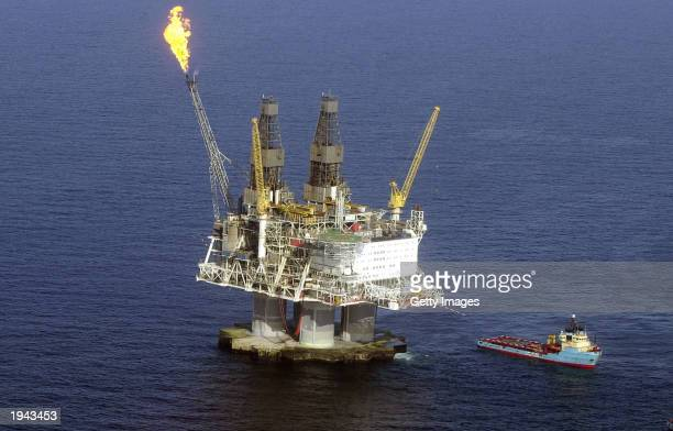 A flame burns off excess gas fumes on the top of the fivebillion dollar drilling platform Hybernia off the coast of Newfoundland April 21 2003 in the...