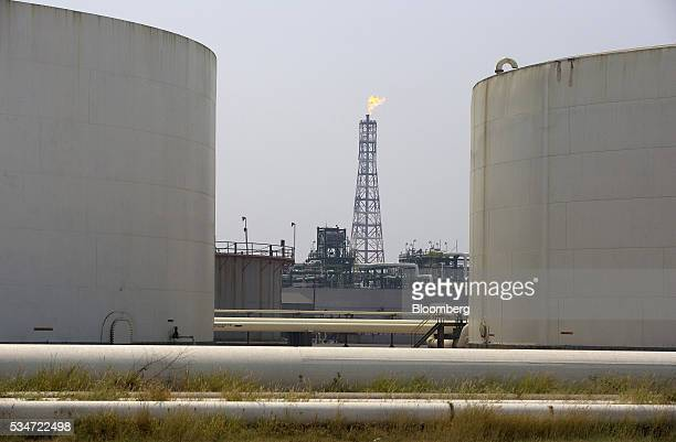 A flame burns on top of a tower at the Petroleos Mexicanos Antonio Dovali Jaime refinery in Salina Cruz Mexico on Thursday May 26 2016 Petroleos...
