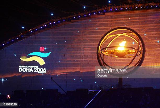 A flame burns within the astrolabe during the Opening Ceremony of the 15th Asian Games Doha 2006 at the Khalifa stadium in Doha Qatar on December 1...