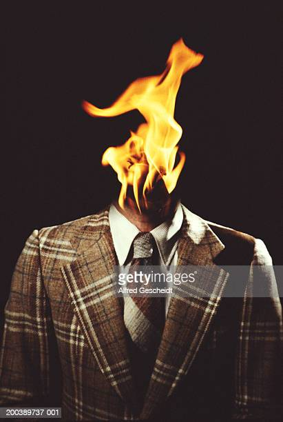 flame coming from businessman's neck (digital composite) - headless man stock pictures, royalty-free photos & images