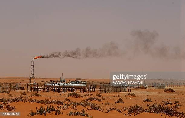 A flame from a Saudi Aramco oil installion known as Pump 3 is seen in the desert near the oilrich area of Khouris 160 kms east of the Saudi capital...