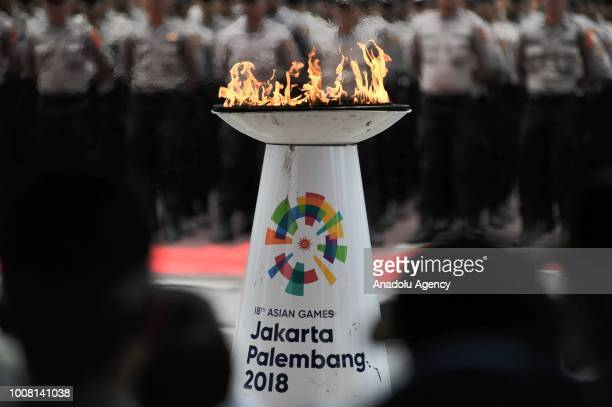 A flame holder is seen during the Asian Games torch relay in Banda Aceh Indonesia on July 31 2018 The 18th Asian Games is scheduled to begin in...