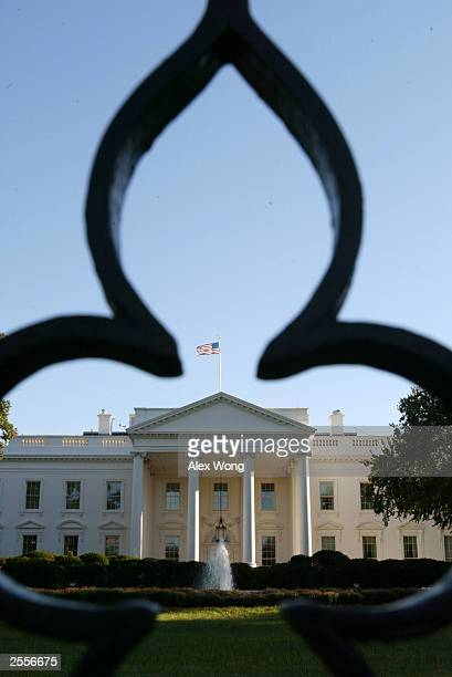 A flame pattern from the White House fence is formed on the building October 2 2003 in Washington DC According to a Washington Post/ABC News poll...