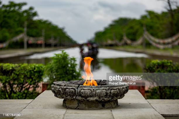 flame - lumbini nepal stock pictures, royalty-free photos & images