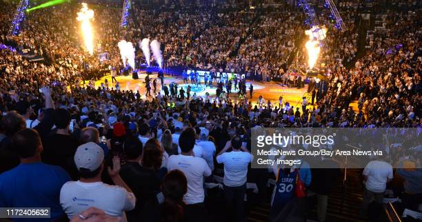 Flame shoot into the air as Golden State Warriors' Stephen Curry enters the court before the start of the Warriors game against the San Antonio Spurs...
