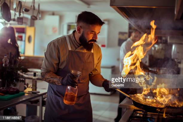 flamed - chef stock pictures, royalty-free photos & images