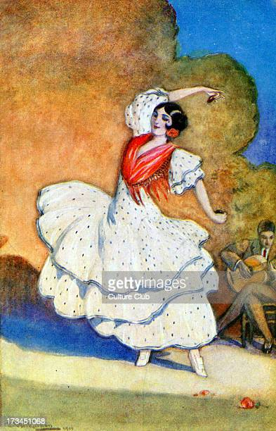 Flamenco dancer Accompanying herself with castanets music played by a man with a guitar