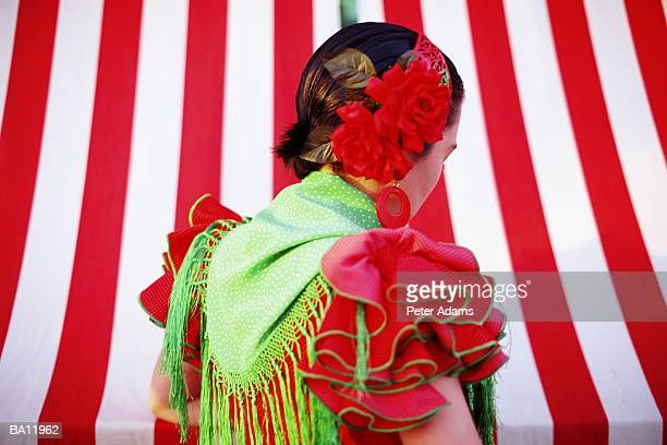 flamenco dancer at fair, rear view - seville stock pictures, royalty-free photos & images