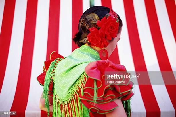 flamenco dancer at fair, rear view - flamenco photos et images de collection