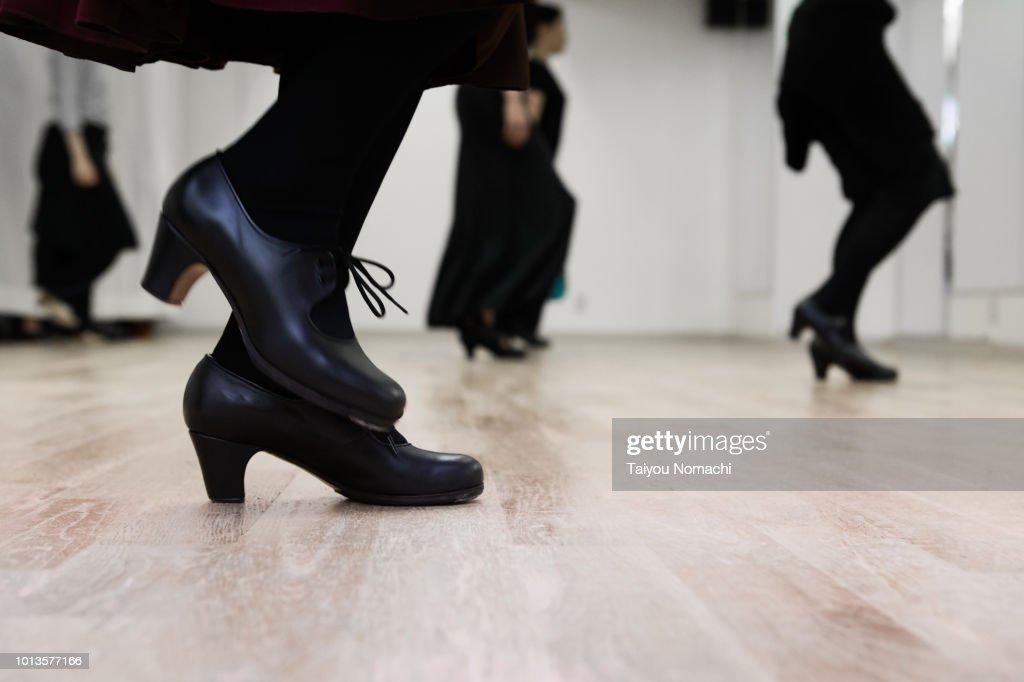 Flamenco dancer kicking the floor : Stock Photo
