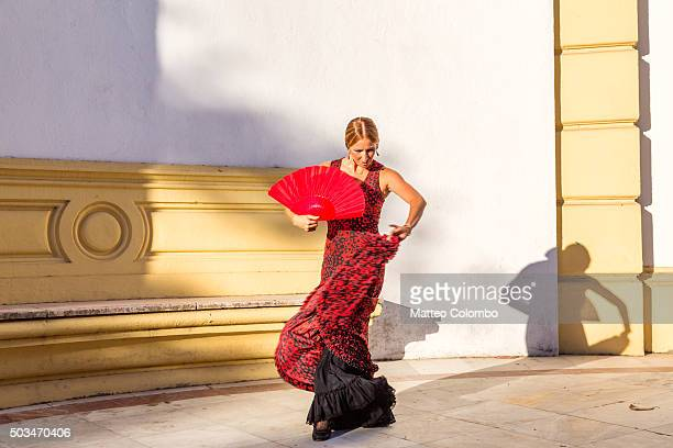 flamenco dancer performing outdoors in seville, andalusia, spain - spanien stock-fotos und bilder