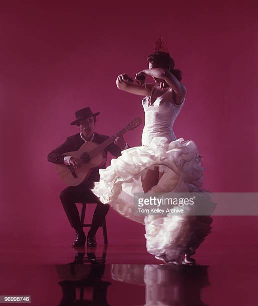 Flamenco Dancer with guitar player perform El baile flamenco against a red background in circa 1983