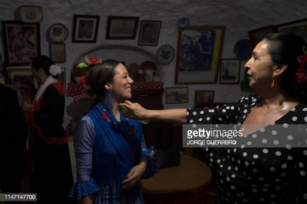 Flamenco dancers splash on some perfume before a Zambra dance performance in the Cueva Maria la Canastera at Sacromonte neighbourhood in Granada on...