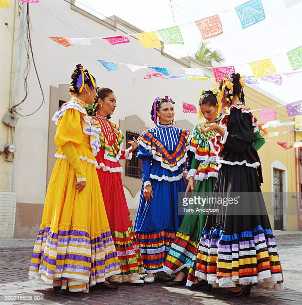 flamenco dancers wearing traditional dress at fiesta - merida mexico stock photos and pictures