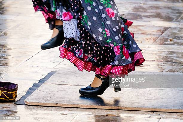 flamenco dancing in the street. - flamenco dancing stock photos and pictures
