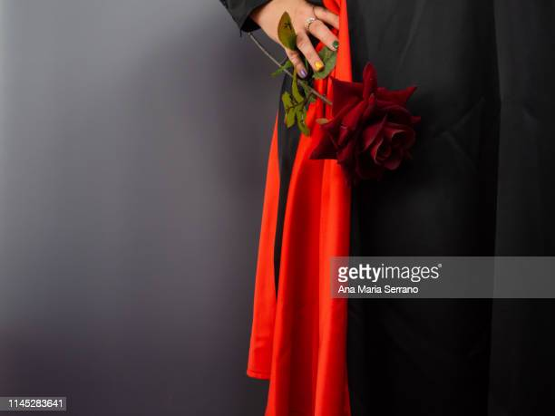a flamenco woman with a rose and red and black skirt. - アシメトリードレス ストックフォトと画像