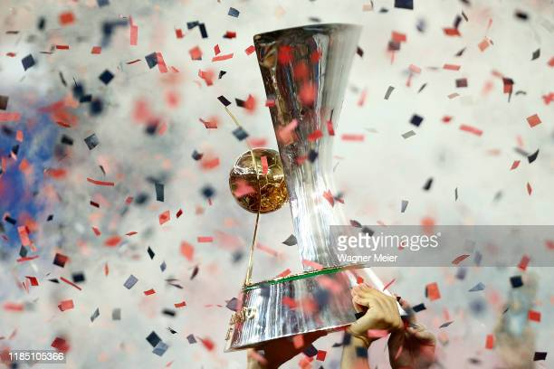 Flamengo captain Everton Ribeiro holds the trophy after winning the Brasileirao 2019 after the match against Ceara at Maracana Stadium on November...