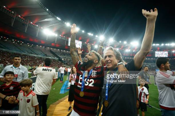 Flamengo coach Jorge Jesus reacts with Flamengo player Gabriel Barbosa after winning the Brasileirao 2019 after the match against Ceará at Maracana...