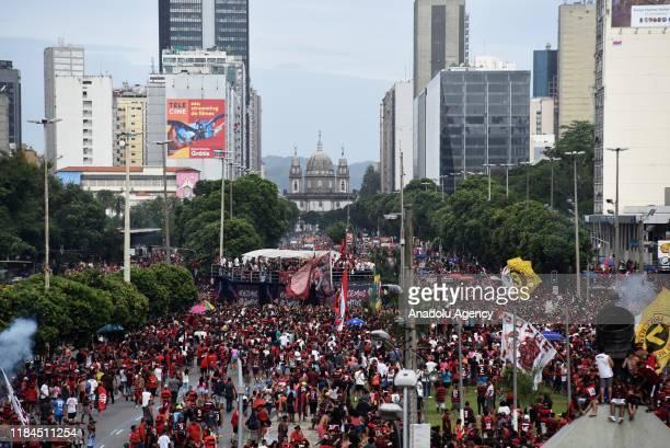 Flamengo fans celebrate as the players parade the city over a bus after Flamengo won the Copa CONMEBOL Libertadores in Candelaria downtown of Rio de...