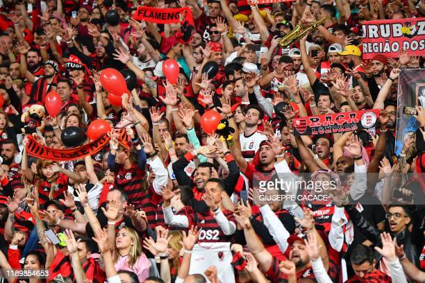 Flamengo fans cheer ahead of the the 2019 FIFA Club World Cup Final football match between England's Liverpool and Brazil's Flamengo at the Khalifa...