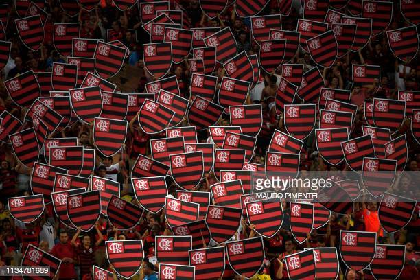 TOPSHOT Flamengo fans cheer before the Copa Libertadores 2019 football match between Brazil's Flamengo and Uruguay's Penarol at Maracana stadium in...