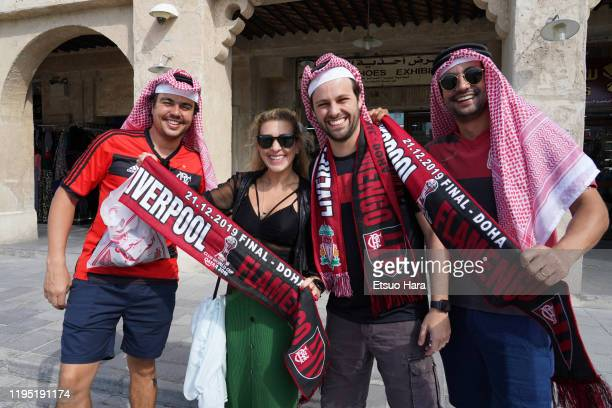 Flamengo fans pose for photographs at the Souq ahead of the FIFA Club World Cup Final match between Flamengo and Liverpool FC on December 21 2019 in...