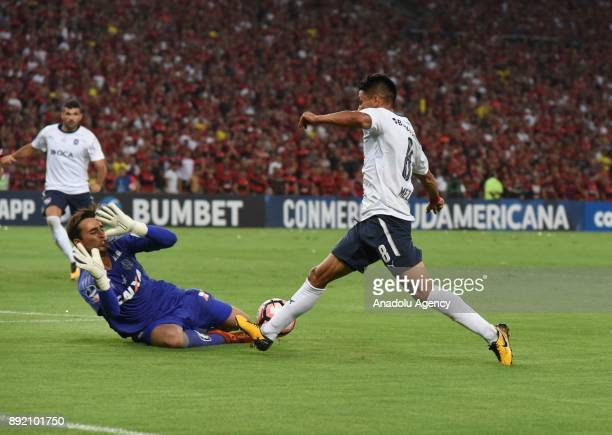 Flamengo goalkeeper Cesar in action against Diego Rodriguez of Independiente during the 2017 Sudamericana Cup championship final match between...