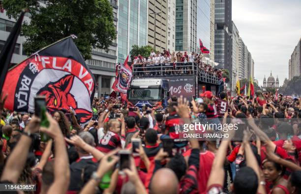 TOPSHOT Flamengo players take part in a celebration parade atop a truck upon arrival following their Libertadores final match victory over...