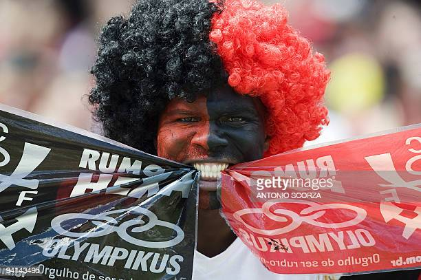 A Flamengo supporter cheers his team before the start of the Brazilian Championship final date match against Gremio at the Maracana stadium on...