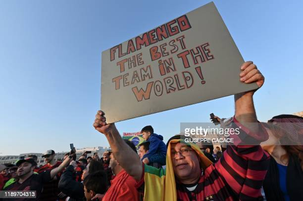 A Flamengo supporters cheers at the traditional Soud Waqif square in the Qatari capital Doha on December 20 2019 on the eve of the 2019 FIFA Club...