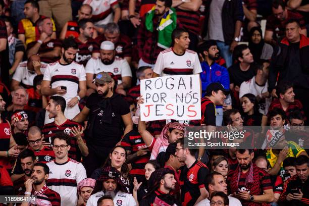 Flamengo supporters hold a sign that says Pray for us Jesus during the FIFA Club World Cup Final match between Liverpool FC and CR Flamengo at...