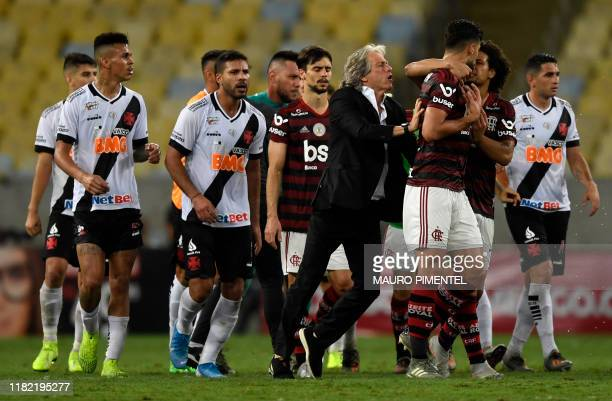 Flamengo team coach Jorge Jesus interferes as Flamengo players argue with Vasco da Gama players during a 2019 Brazilian Championship football match...