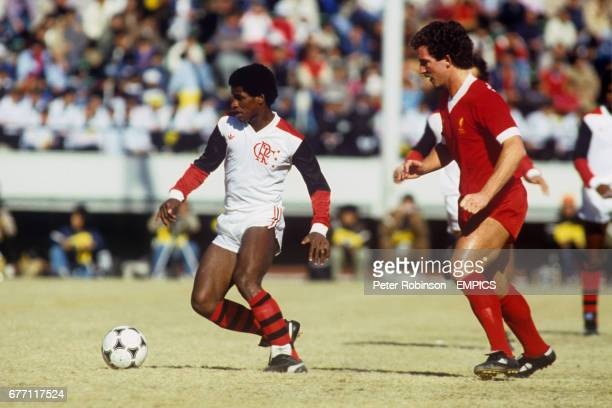 Flamengo's Adilio gets away from Liverpool's Graeme Souness