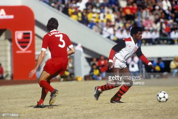 Flamengo's Adilio gets away from Liverpool's Mark Lawrenson