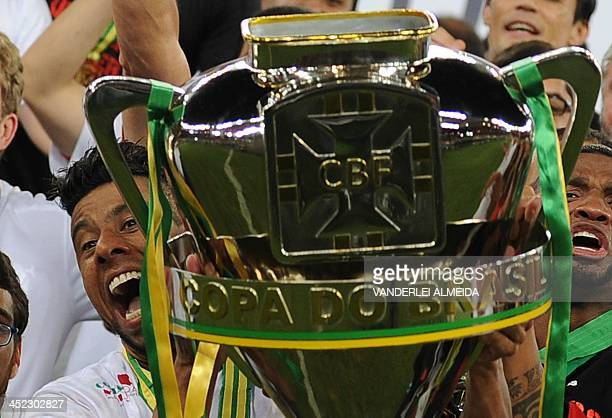 Flamengo's captain Leo Moura celebrates victory over Atletico PR following their Brazil Cup Championship football match-final at the Mario Filho...