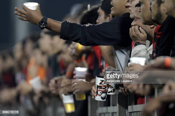 Flamengo's fan holds a glass of beer with a cartoon of the old flamengo idol Zico during the match between Flamengo and Ponte Preta as part of...