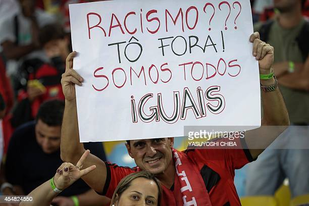 Flamengo's fan holds a message against racism before their Brazilian championship match against Gremio at Maracana stadium in Rio de Janeiro Brazil...