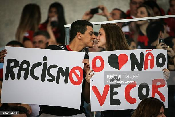 Flamengo's fans hold a message against racism before their Brazilian championship match against Gremio at Maracana stadium in Rio de Janeiro Brazil...