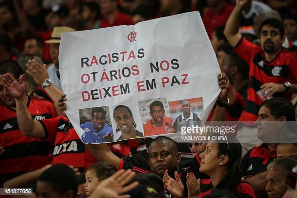 Flamengo's fans hold a placard against racism before their Brazilian championship match against Gremio at Maracana stadium in Rio de Janeiro Brazil...