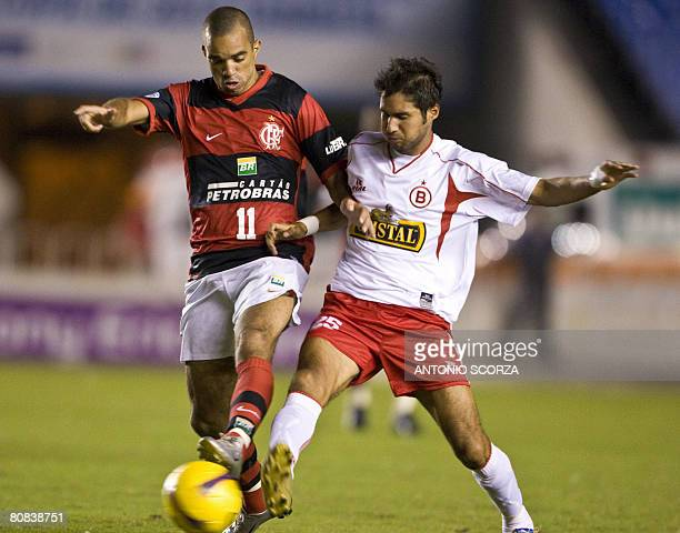 Flamengo's footballer Diego Tardeli vies for the ball with Alberto Uribe of Coronel Bolognesi of Peru on April 23 2008 during a Libertadores Cup...