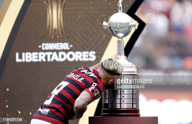 Flamengo's Gabriel Barbosa kisses the trophy after winning the Copa Libertadores final football match by defeating Argentina's River Plate at the...