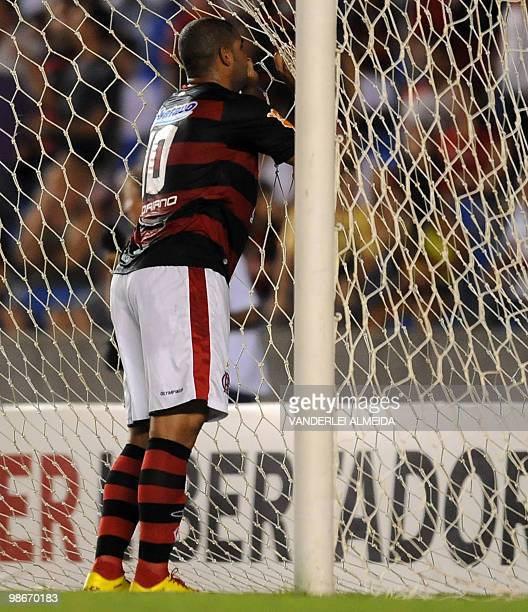 Flamengo's player Adriano reacts after missing a goal against Caracas during their Libertadores Cup football match at Maracana stadium in Rio de...