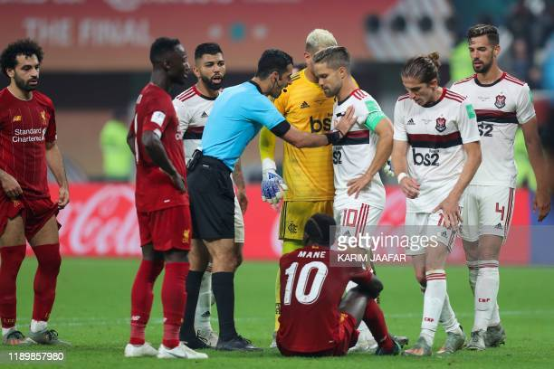 Flamengo's players argue with the referee during the 2019 FIFA Club World Cup Final football match between England's Liverpool and Brazil's Flamengo...