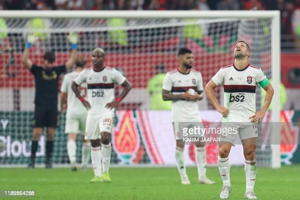 Flamengo's players react to their defeat during the 2019 FIFA Club World Cup Final football match between England's Liverpool and Brazil's Flamengo...