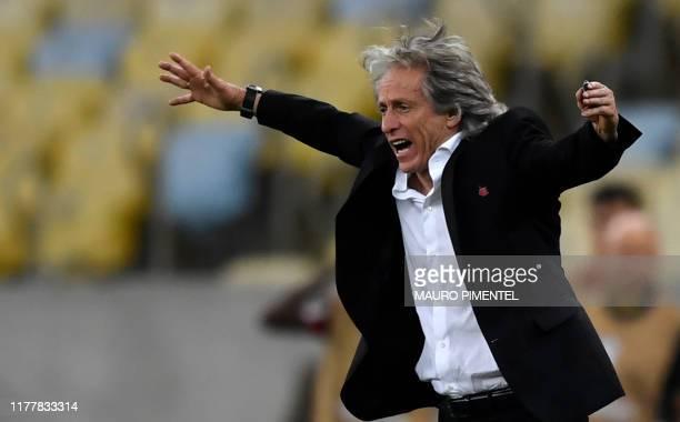 Flamengo's team coach Paulo Cesar Carpegiani gestures during their Copa Libertadores semifinal second leg football match against Gremio at Maracana...