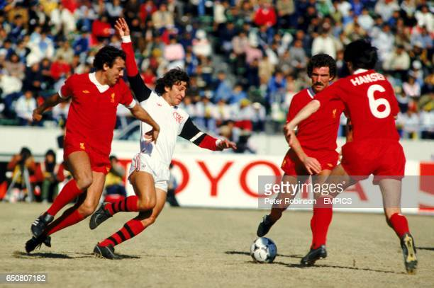 Flamengo's Zico takes on Liverpool's Ray Kennedy Graeme Souness and Alan Hansen